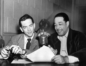 African-American composer, pianist, bandleader and Jazz musician Duke Ellington and broadcaster and Jazz producer Willis Conover during a radio show, Washington DC, November 10, 1949. (Photo by Afro American Newspapers/Gado/Getty Images)